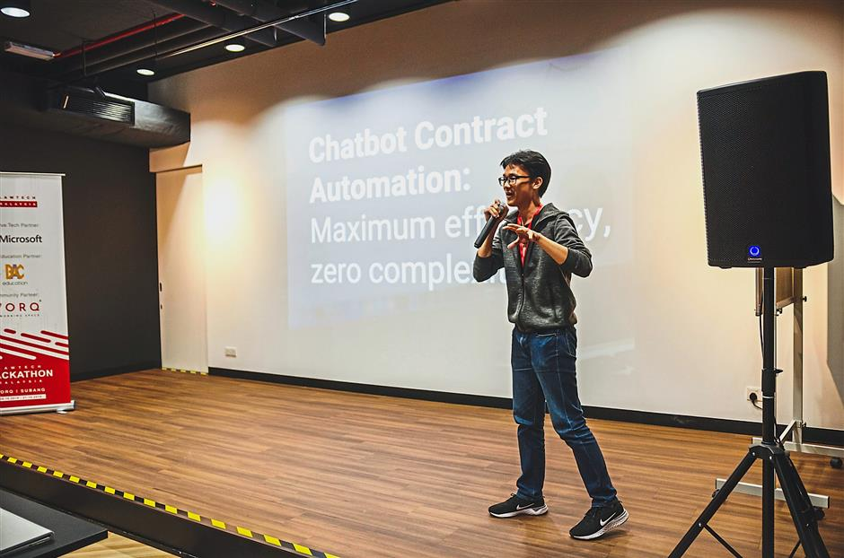 Choo pitching his team's idea – contract automation chatbot called AskLaw – which won the top prize at the hackathon. — Photos: Marque Tan