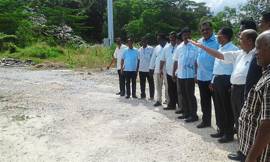 Available spot: The committee members looking at the proposed site for the school.