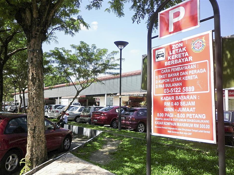 A notice board is seen in Section 2, Shah Alam to inform those who want to park in the area of the parking rates and the coupon system.