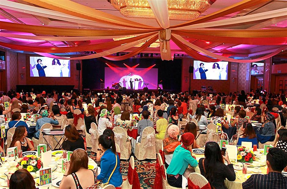 The hotel ballroom packed to the brim for The Body Shop Malaysia 30th anniversary dinner in Kuala Lumpur where staff impersonate singers and bands from the '80s. 11 June 2014 CHAN TAK KONG/The Star