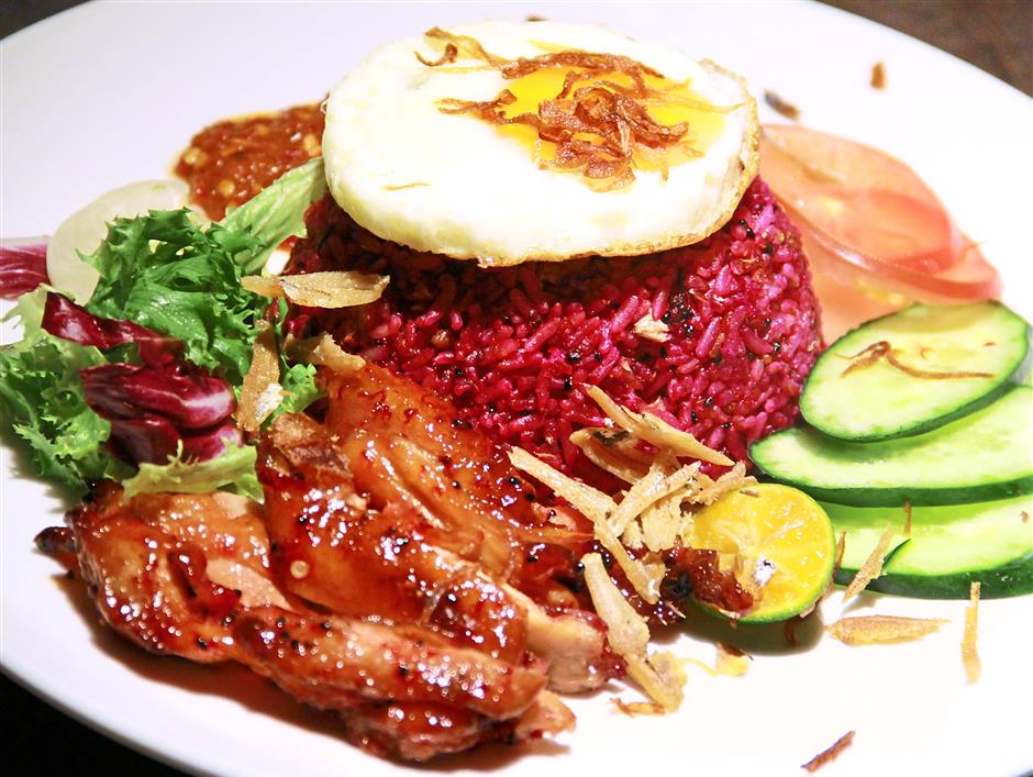 The Dragonfruit Fried Rice stands out for its reddish-hued rice and chicken flecked with the dragonfruit seeds.