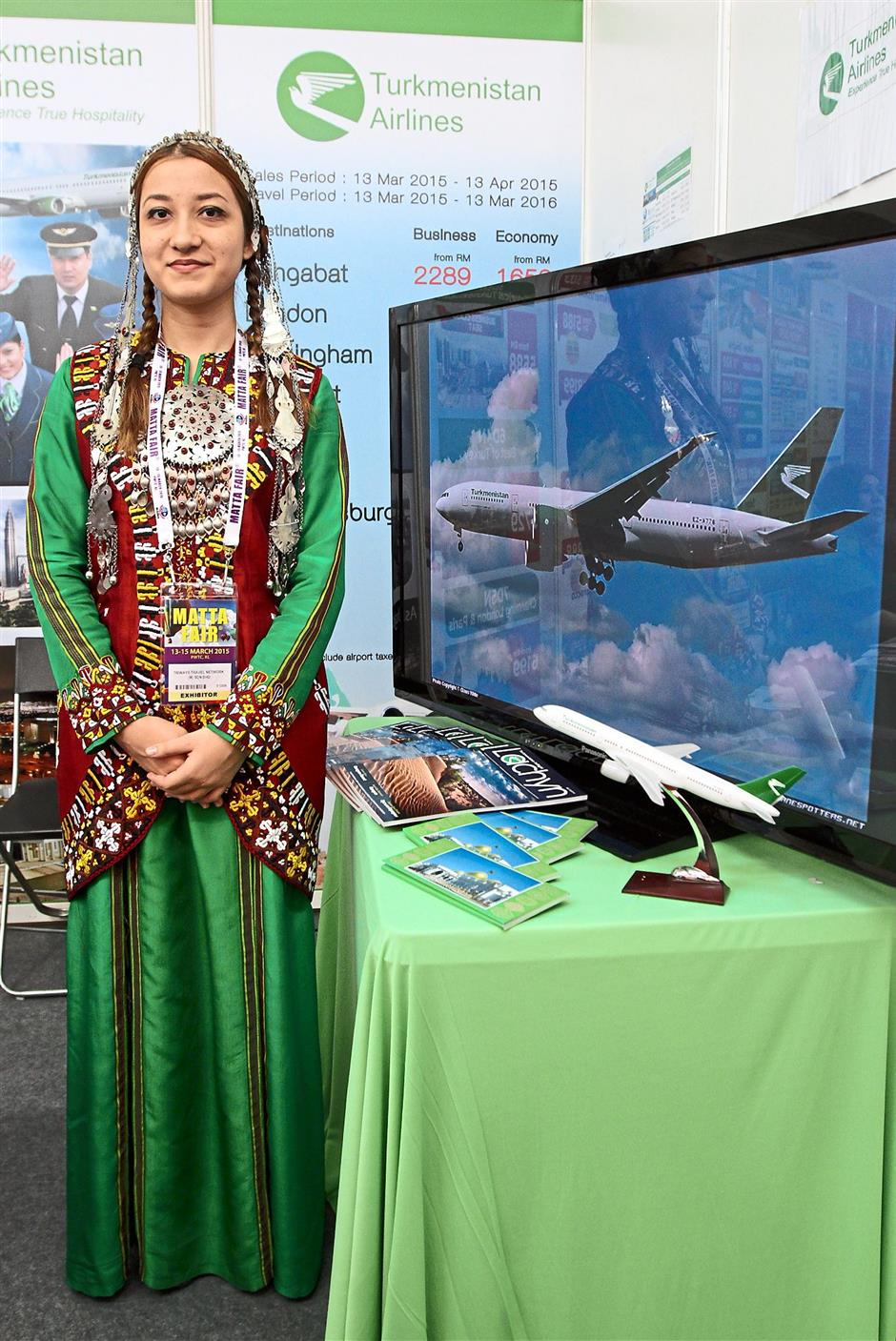 Glimpse of their culture: A sales promoter wearing the traditional Turkmenistan costume.