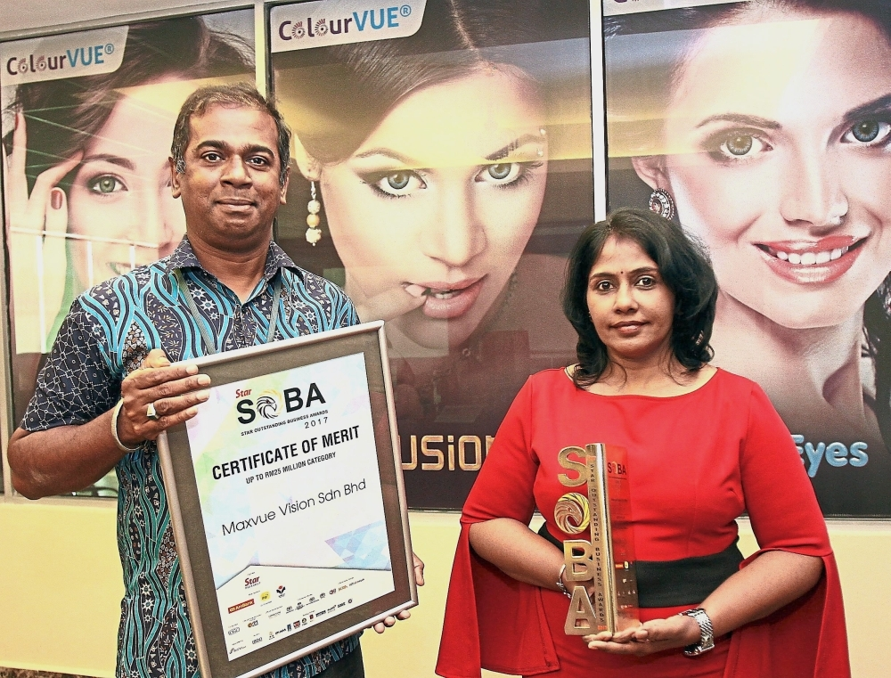 Selvam and Viji with the awards the company won at the Star Outstanding Business Awards 2017. Maxvue Vision walked away with the Gold for Best in CSR and the Silver for Best in Marketing and Best Innovation in the Up To RM25mil In Sales Turnover category.