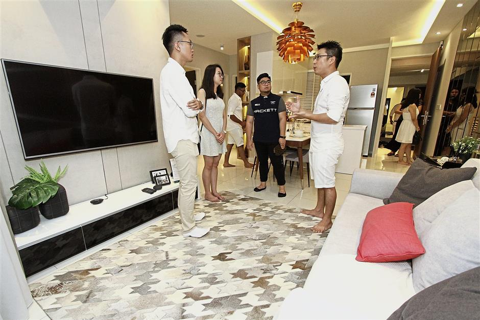 Guests checking out a Tri Pinnacle condominium showroom at the topping out ceremony.