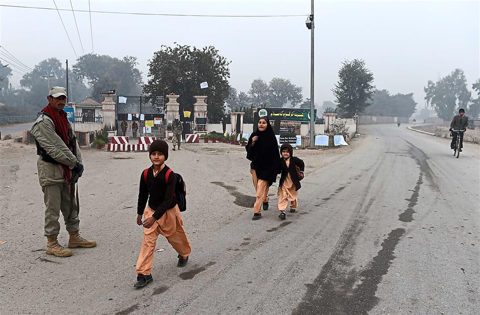 Tension: The journey to school whether by vehicle or on foot can be stressful for school-going children in Pakistan. - AFP