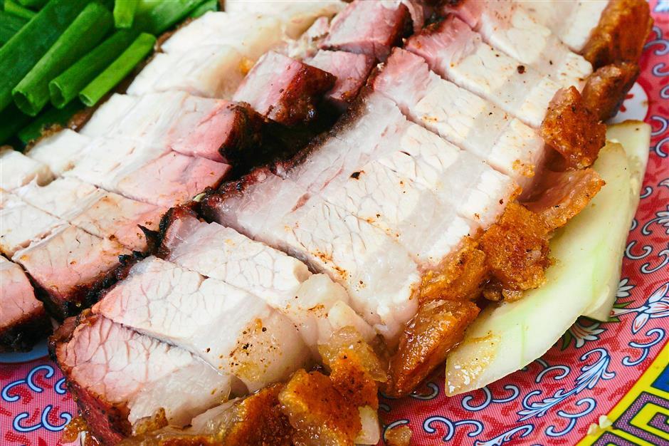 Spicy goodness: Hong Seng Restaurant's tender and crispy skinned siew yoke is paired with the restaurant's homemade chilli.