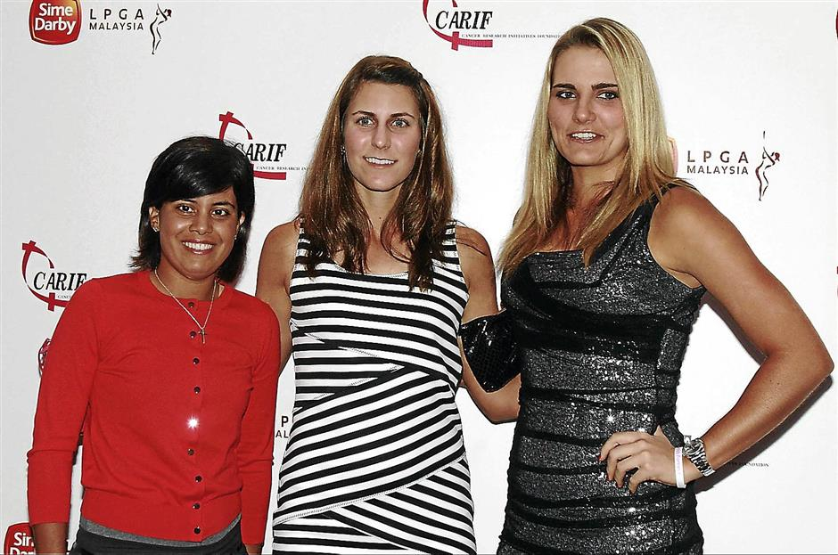 (from left) Golfers Julieta Granada, Jennifer Johnson, Lexi Thompson at the Sime Darby LPGA 2013 Charity Cocktail Evening held at the Sime Darby Convention Centre.