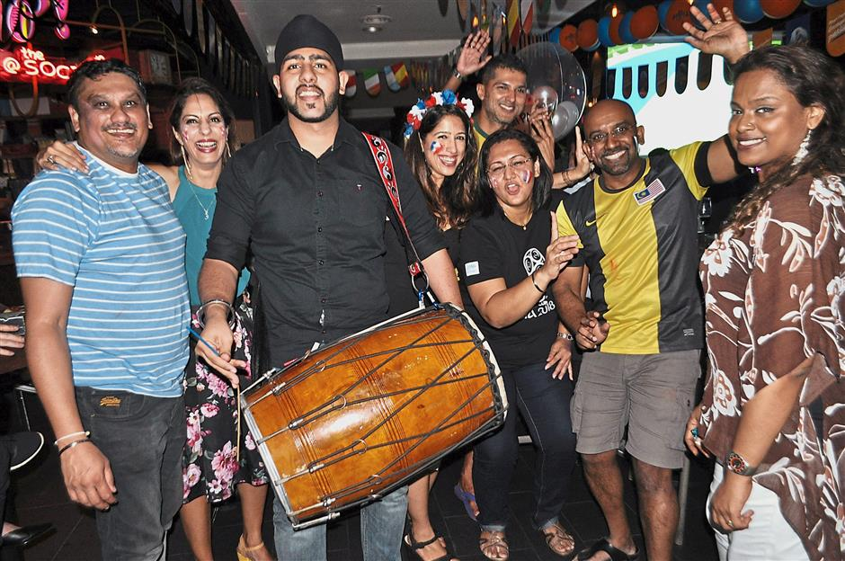 Davinder (third from left) brought his dhol to the Tiger Beer football viewing party at The Square in Publika and it certainly livened the atmosphere.