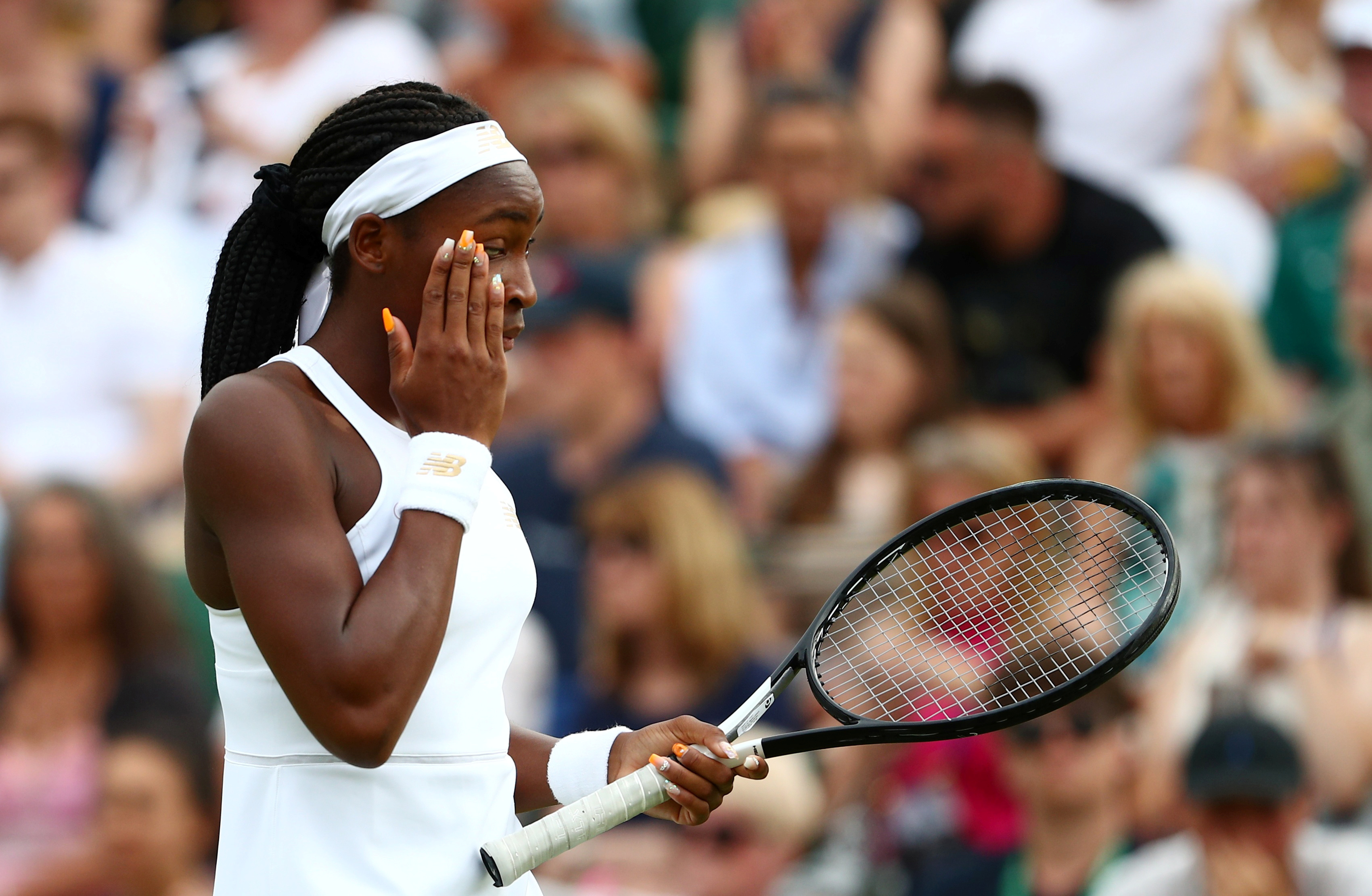 Tennis - Wimbledon - All England Lawn Tennis and Croquet Club, London, Britain - July 6, 2019  Cori Gauff of the U.S. looks dejected after losing her first round mixed doubles match against Sweden's Robert Lindstedt and Latvia's Jelena Ostapenko  REUTERS/Hannah McKay