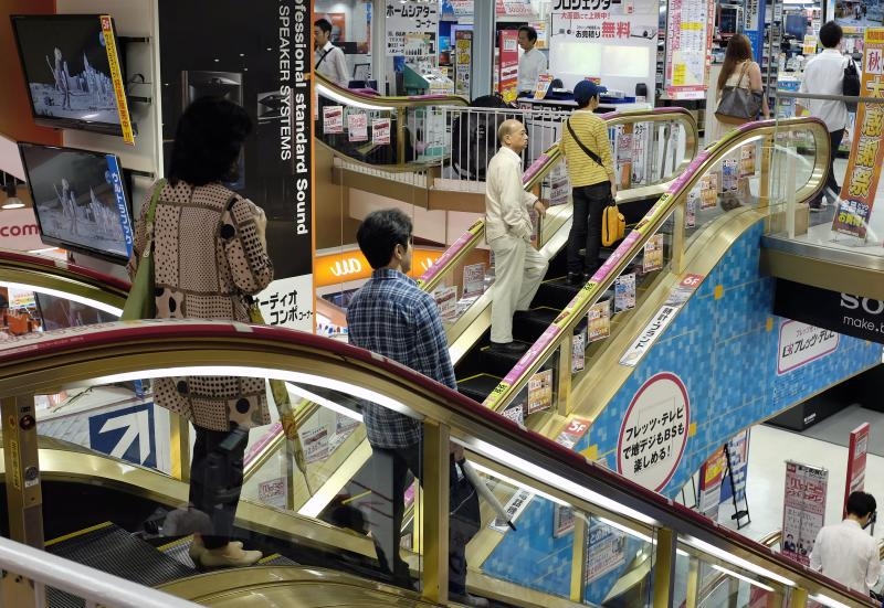 Japan\'s economy expanded 0.5% in July-September, compared to 0.9% in April-June, but consumer spending before the sales tax hike next year should help Q4 performance - EPA Photo.