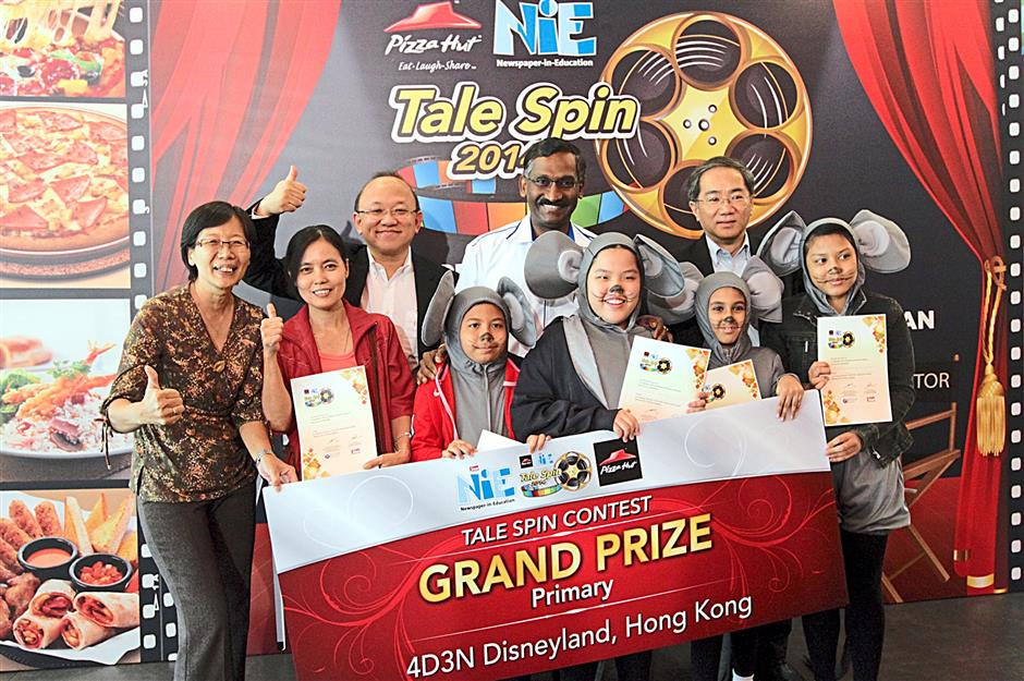 Winning team: (Back row, from left) Low, Kamalanathan and Kan posing with Team The Four Buttercups during the prize-giving ceremony.