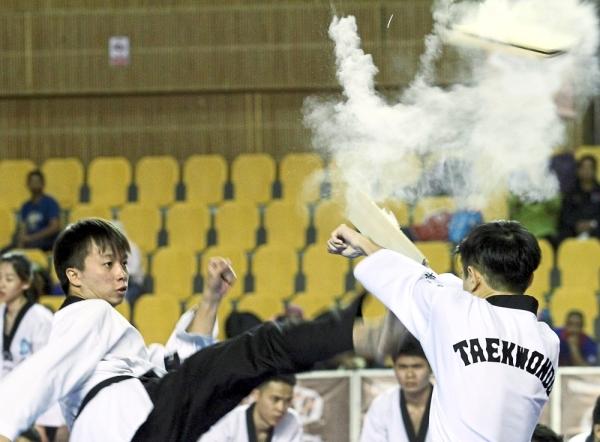 Universiti Tunku Abdul Rahman's Taekwondo Club members delivering an energetic performance during the closing ceremony of the championship.