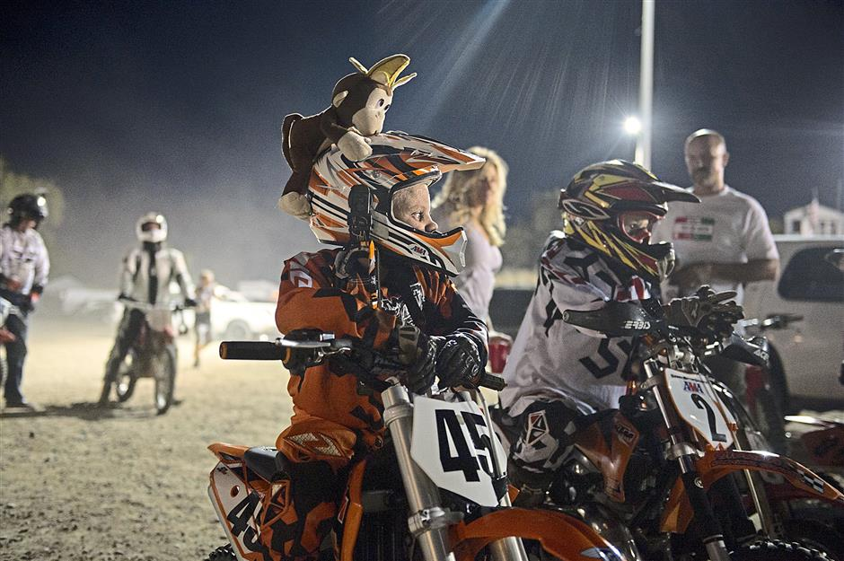 Colton (with the funky helmet) waits for his first race last month at Big Time Speedway in Prairie City, California. — MCT