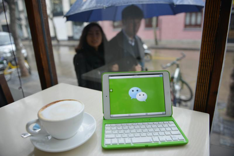 The logo of Chinese instant messaging platform called WeChat, which has taken the country by storm in just three years. Chinese Internet giant Tencent poses a big challenge to Ali Baba\'s dominance of e-commerce in China with its payment function known as Weixin - AFP Photo.