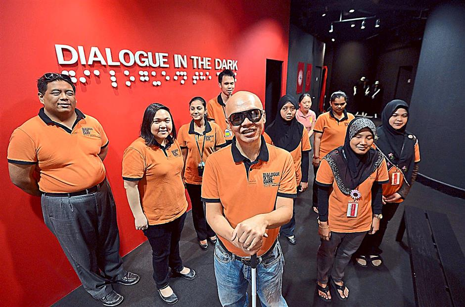 Stevens Chan (centre)  and his team who organise Dialogue in the Dark at Petrosains, KLCC.