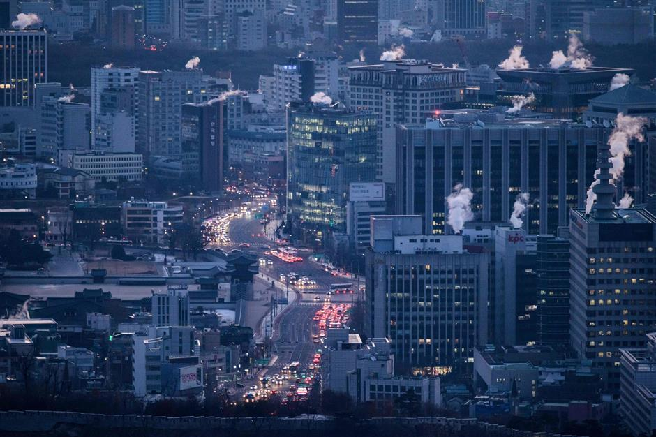 A photo taken on January 12, 2018 shows a general view of the Seoul city skyline. - Spycam crimes have become so prevalent in South Korea that female police officers now regularly inspect public toilets to check for cameras in women's stalls. Under current regulations, spycam buyers are not required to give personal information, making it difficult to trace their ownership and use of the devices. (Photo by Ed JONES / AFP) / TO GO WITH AFP STORY SKorea-crime-surveillance-spycam-gender / FOCUS BY Kang Jin-kyu