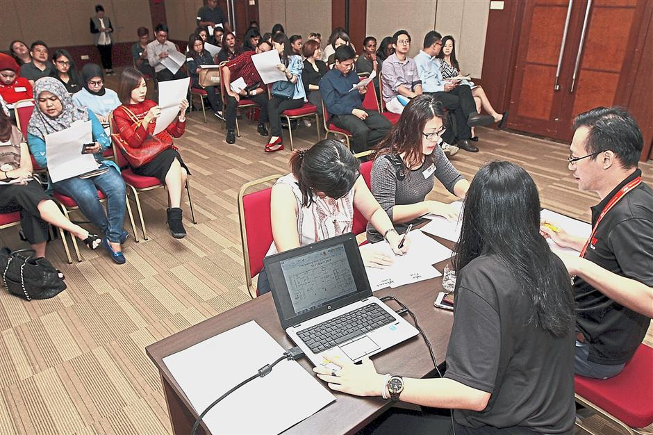 Exhibitors picking their booth location for The Star Womenu2019s Fiesta at a balloting session in Menara Star.