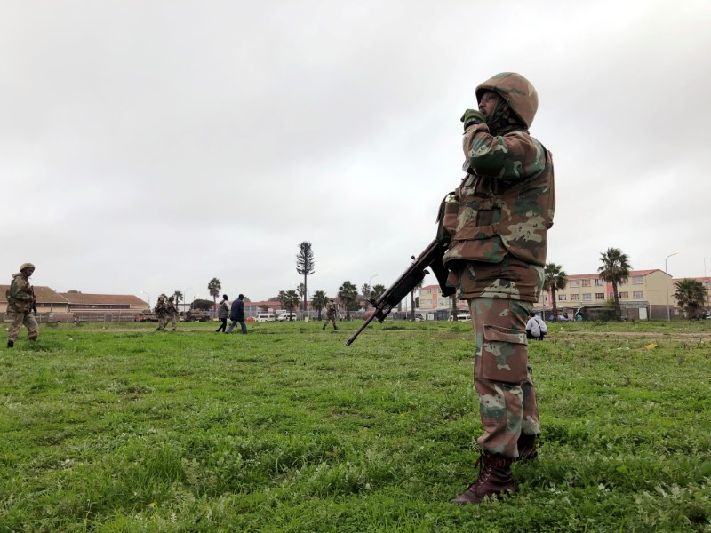 Soldiers patrol as they are deployed to quell gang violence in Manenberg township, Cape Town, South Africa, July 18, 2019. Picture taken July 18, 2019. REUTERS/Shafiek Tassiem