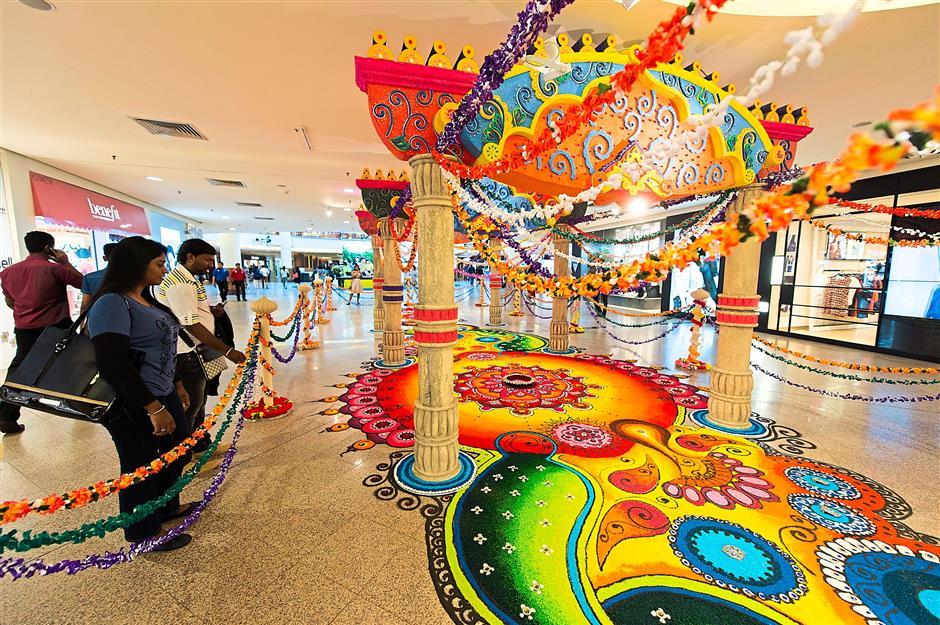 A vibrant kolam sets the festive mood at Mid Valley Megamall.