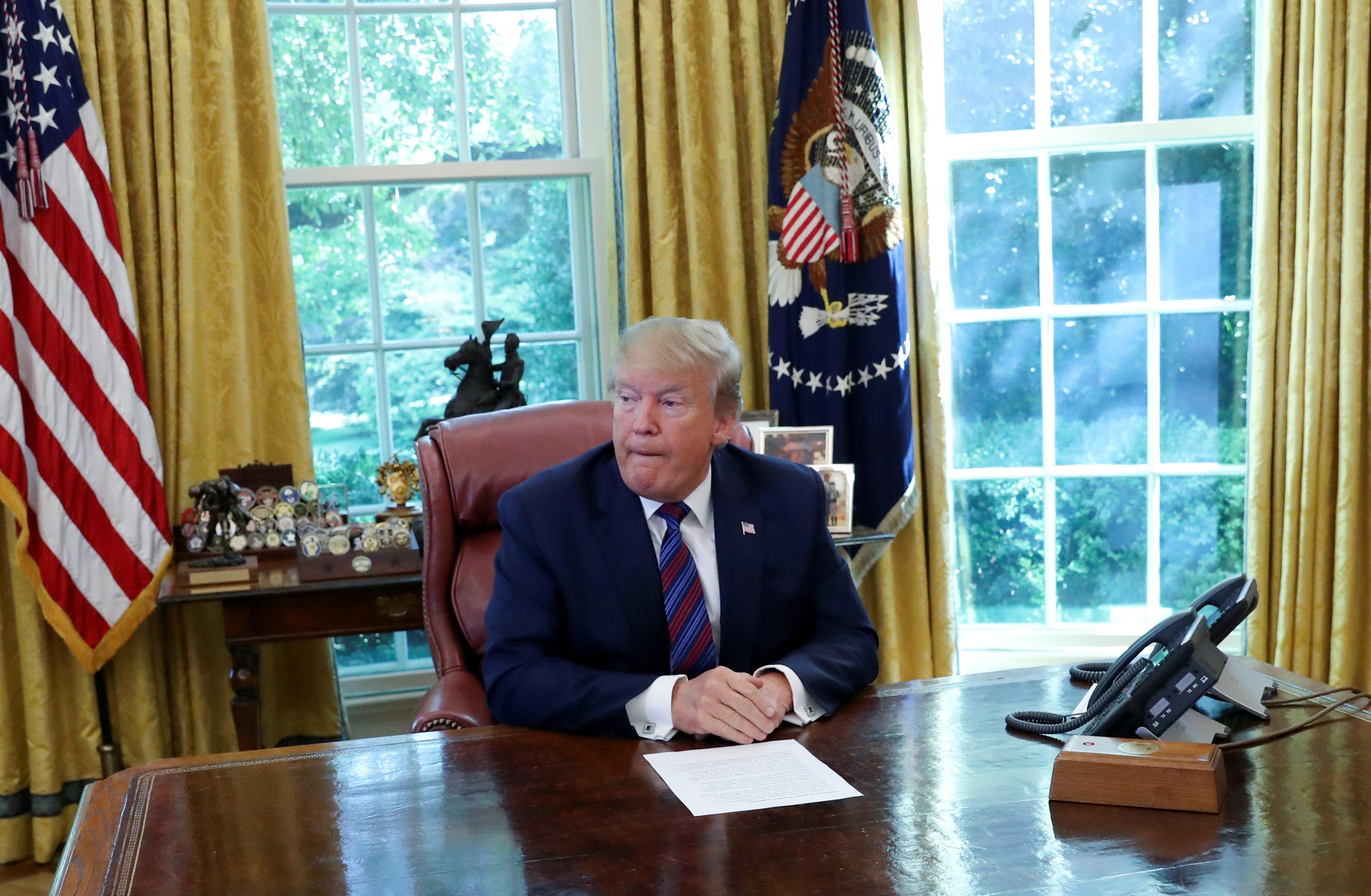 FILE PHOTO: U.S. President Donald Trump speaks in the Oval Office of the White House in Washington, U.S., July 26, 2019. REUTERS/Leah Millis/File Photo