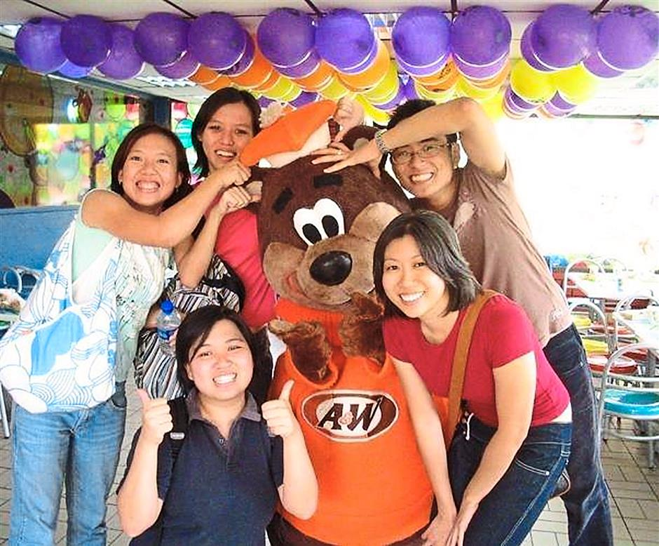 Beary fun: Low (left) with her university friends during one of their visits to the fast-food joint where they chased after the mascot.