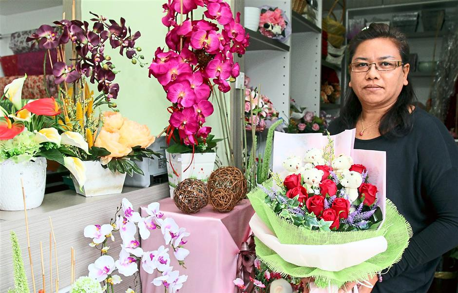 An option: Mong with a bouquet of artificial flowers prepared for Valentine's Day.