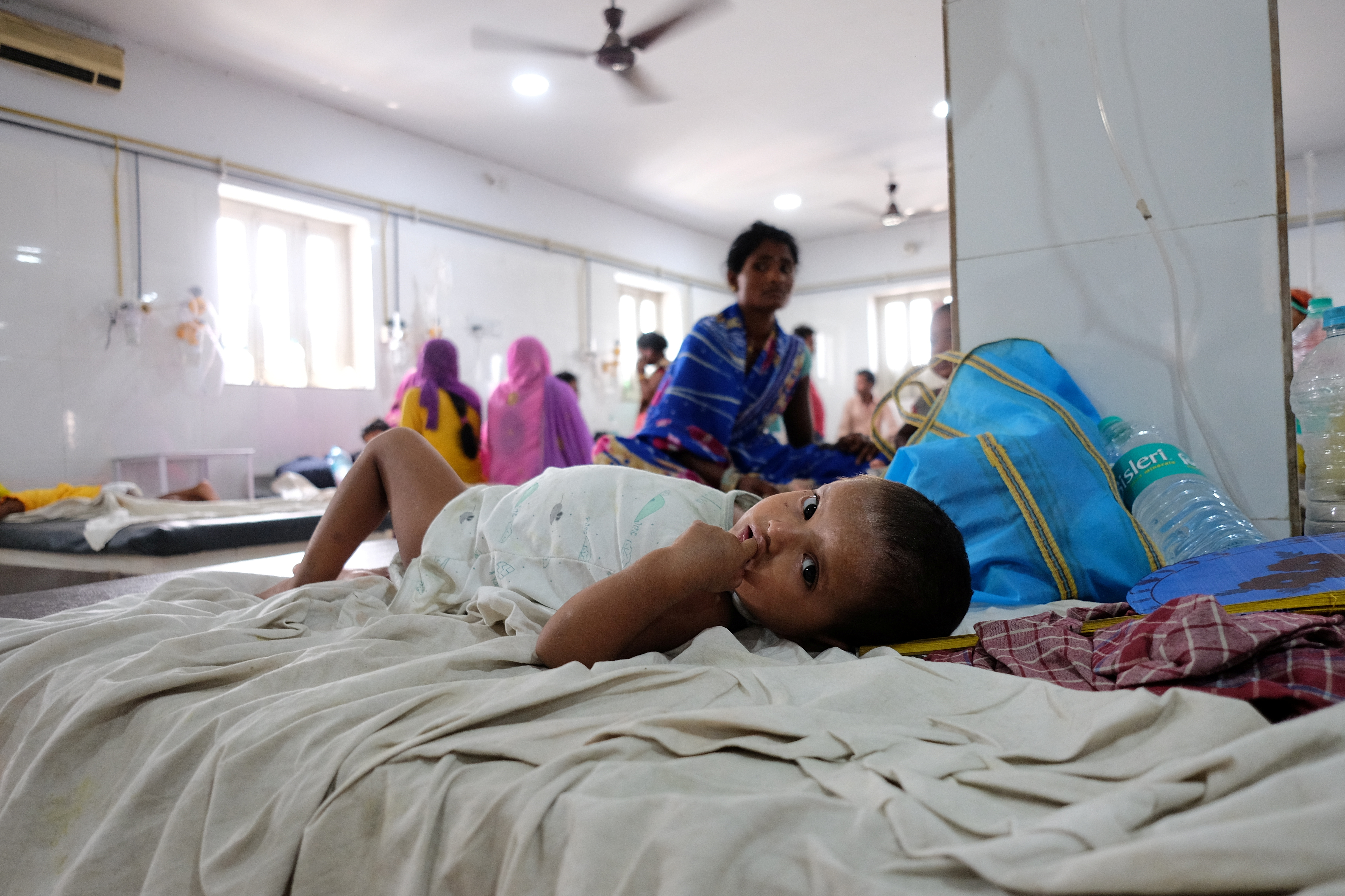 FILE PHOTO: A child suffering from acute encephalitis syndrome lies on a bed at a hospital in Muzaffarpur, in the eastern state of Bihar, India, June 20, 2019. REUTERS/Alasdair Pal