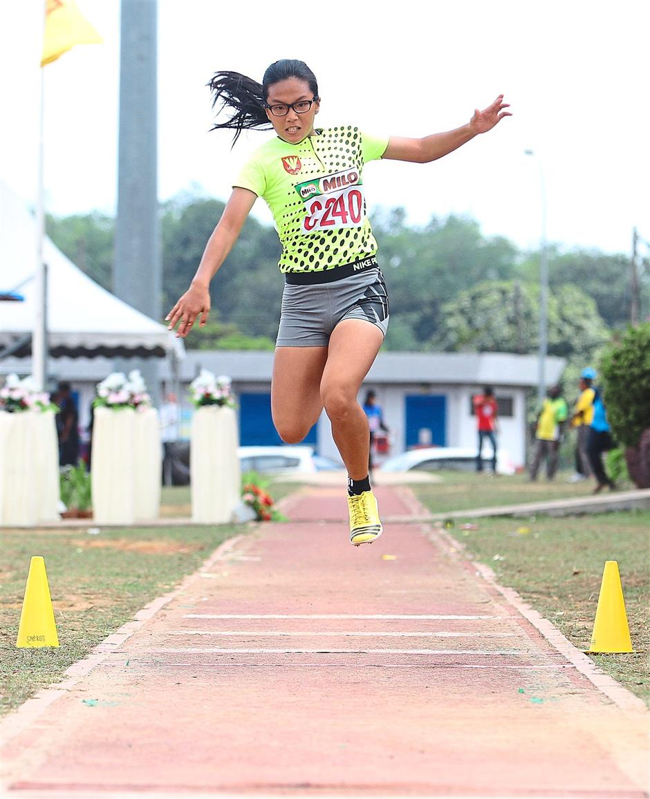 Aiming high: Klang's Angel Tan Yan En in action in the Girls Class One triple jump.
