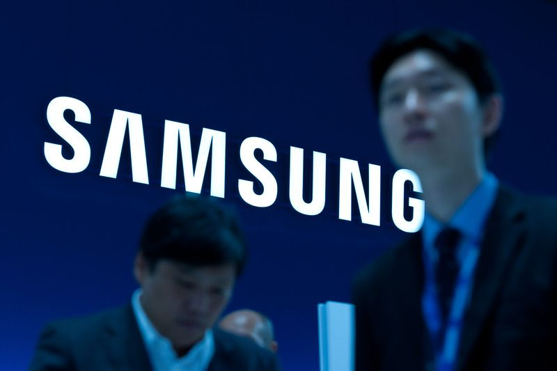 Samsung profit halves as downturn wallops chips and smartphones