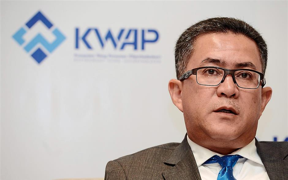 Wan Kamaruzaman says construction is also key to increasing profitability and getting a right partner is crucial, which will be decided by the investment and operations boards.an Ahmad speaks to the media after the announcement of KWAP's 2013 finance results at The Westin Hotel,KL on 25 August 2014.The Star/Sia Hong Kiau.