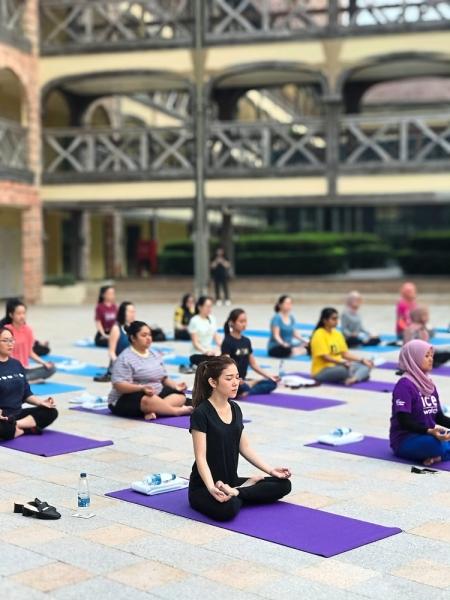 The women settling in for a test on their core strength and flexibility during the yoga session.