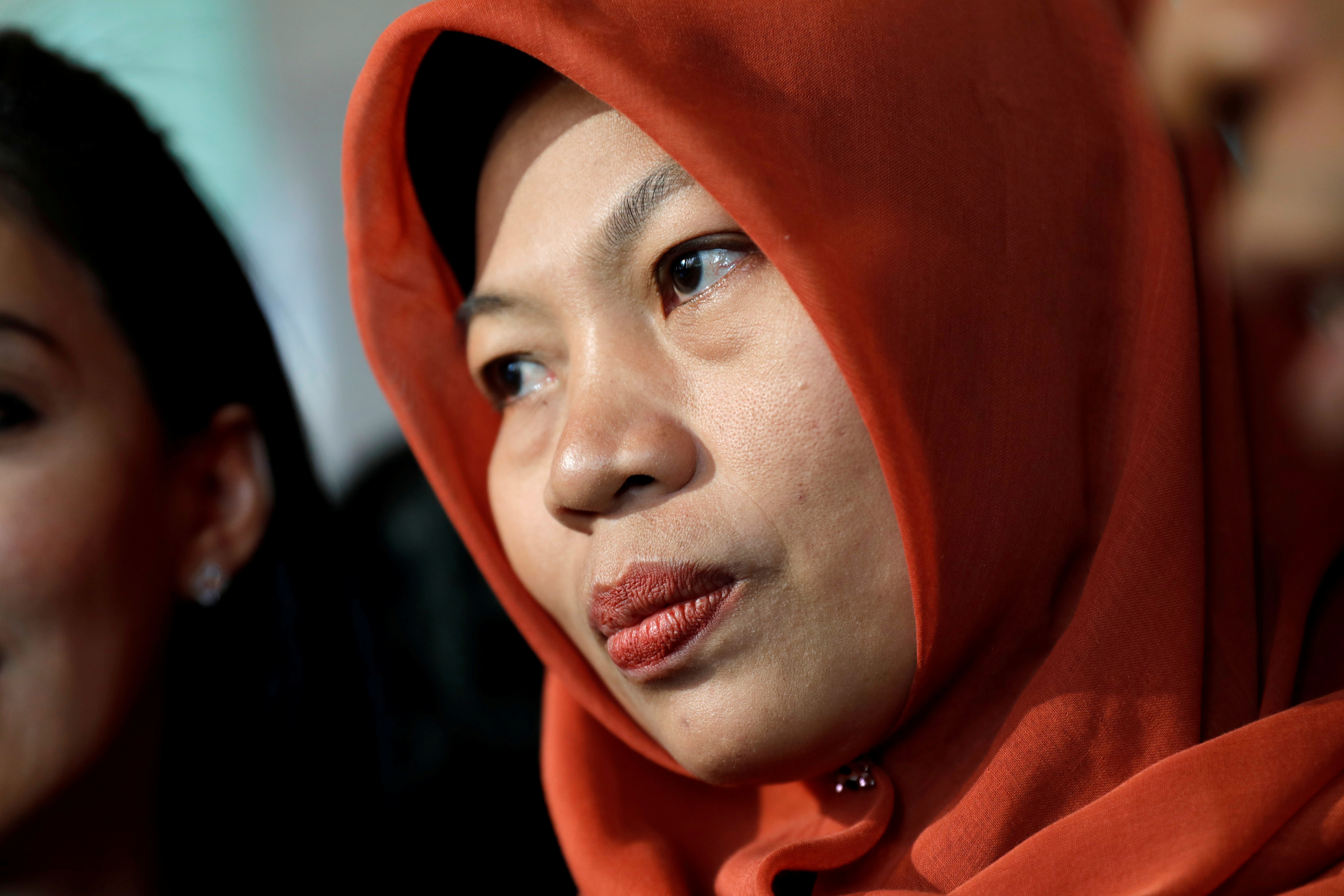 FILE PHOTO: Baiq Nuril Maknun reacts to journalists as she arrives at the Law and Human Rights ministry office in Jakarta, Indonesia, July 8, 2019. REUTERS/Willy Kurniawan/File Photo