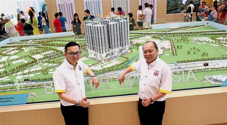 Lim (left) and assistant sales and marketing manager Eddie Chang (right) explaining the connectivity for future  tenants of the Razak City Residences.