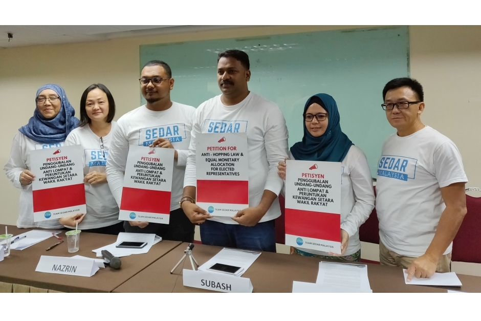 Nazrin (third from left) and the Sedar leadership hold up posters of their petition drive at Wisma MCA in KL on Dec 28, 2018. The petition calls for legislative changes to combat party-hopping among elected representatives, as well as equal allocations for Pakatan and opposition MPs.