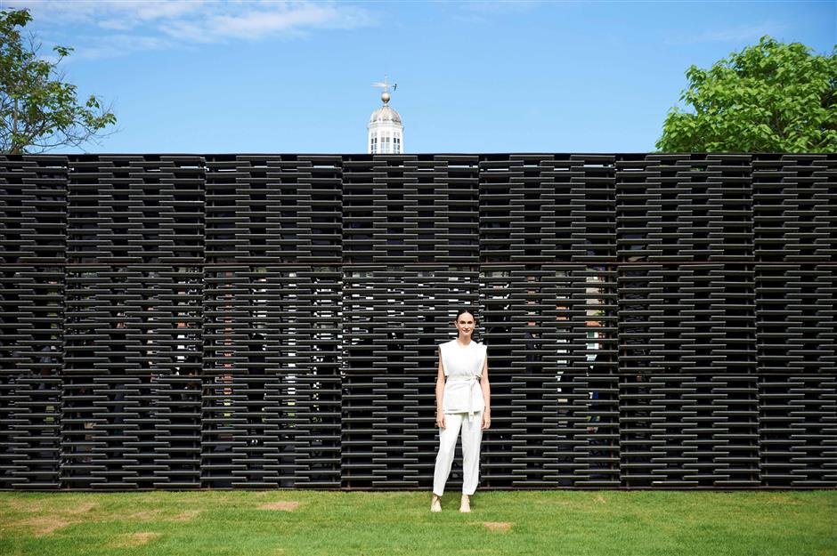 Mexican architect Frida Escobedo poses for a photograph during the press preview of her designed Serpentine Gallery 2018 Pavilion, in Kensington Gardens in west London on June 11, 2018. / AFP PHOTO / NIKLAS HALLE\'N
