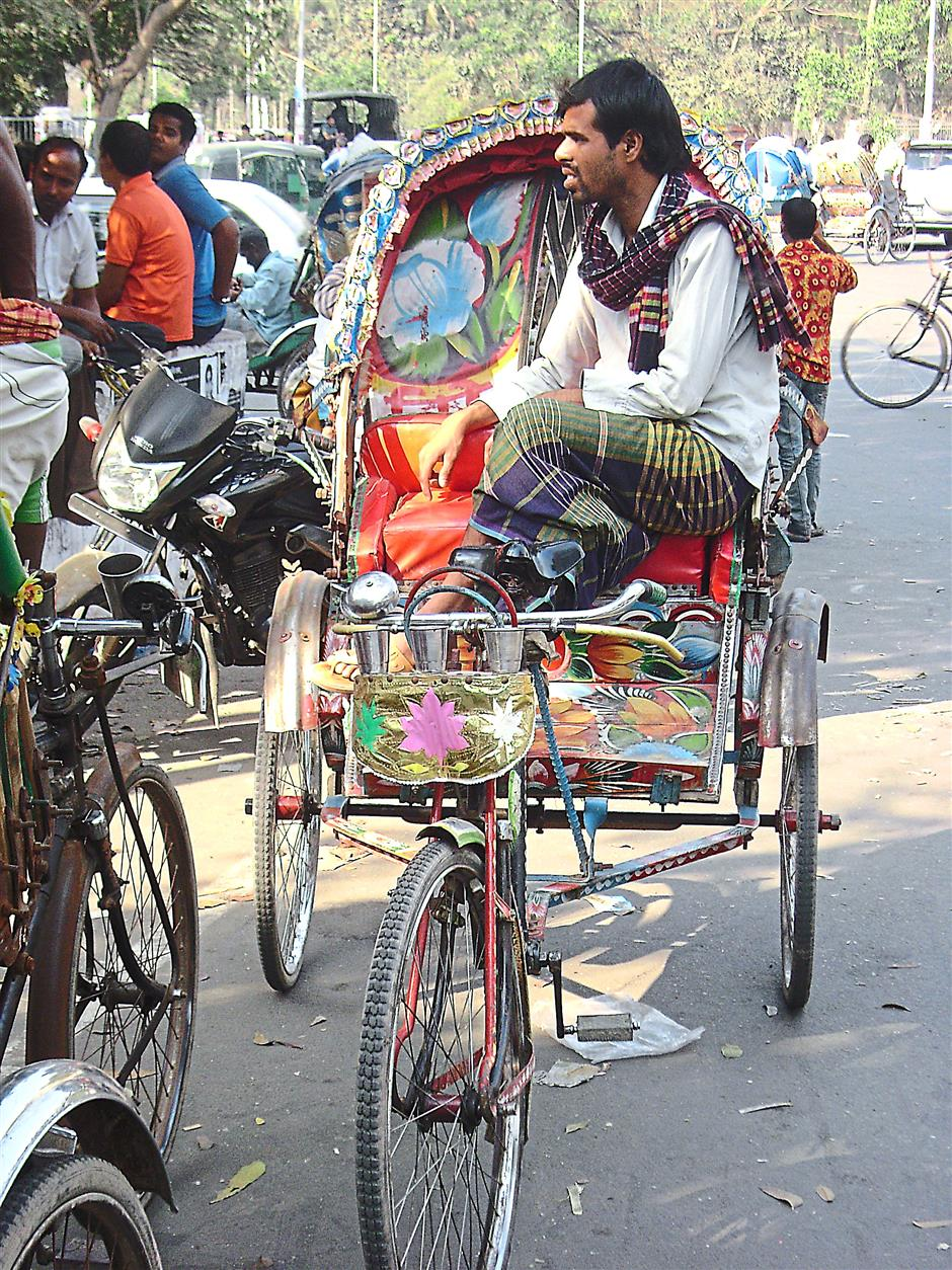 Rickshaws are the usual way to get around in Dhaka.