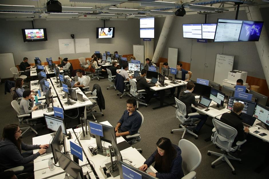 In this Friday, April 5, 2019, photograph provided by Facebook, engineers monitor postings related to the upcoming Indian election and other elections at their operation center at their headquarters in Menlo Park, California. From manipulated pictures being picked up by mainstream news media, to misrepresented quotes sparking communal division, false news and hateful propaganda on digital platforms are at peak levels in the run-up to the Indian general elections. (AP Photo via Facebook)