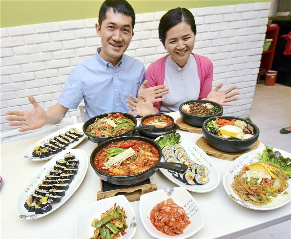 Sibling owners: Julie (right) and Tak Hyun Chan with a sampling of the Korean delicacies they serve at Sopoong, a halal Korean restaurant. — Photos by P. NATHAN
