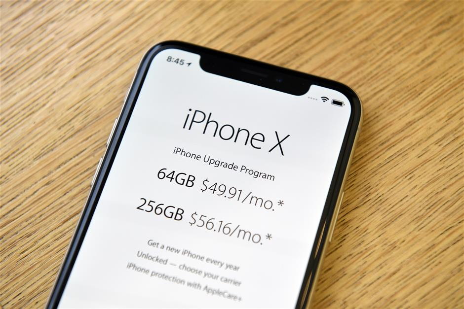 An Apple Inc. iPhone X smartphone is displayed during the sales launch at a store in San Francisco, California, U.S., on Friday, Nov. 3, 2017. The $1,000 price tag on Apple Inc.\'s new iPhone X didn\'t deter throngs of enthusiasts around the world who waited -- sometimes overnight -- in long lines with no guarantee they would walk out of the store with one of the coveted devices. Photographer: Michael Short/Bloomberg