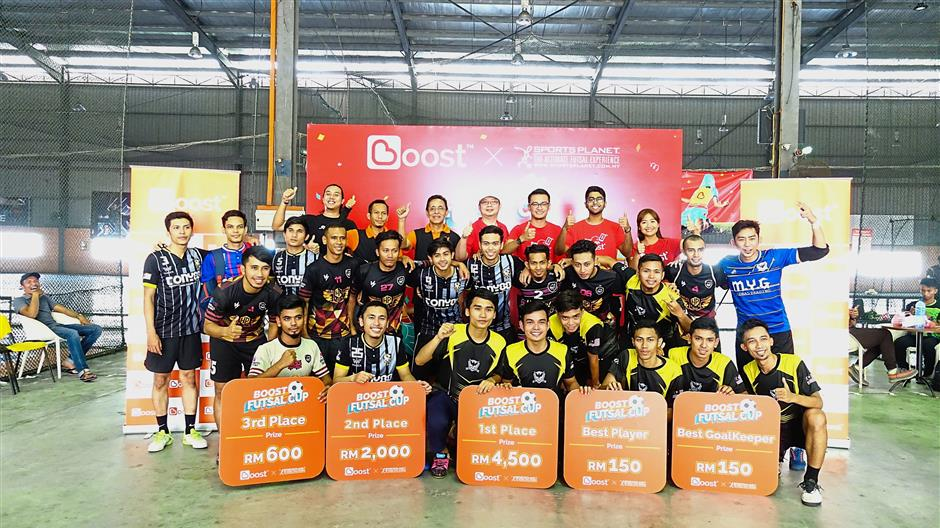 The Boost Futsal Cup winners with Boost and Sports Planet representatives.