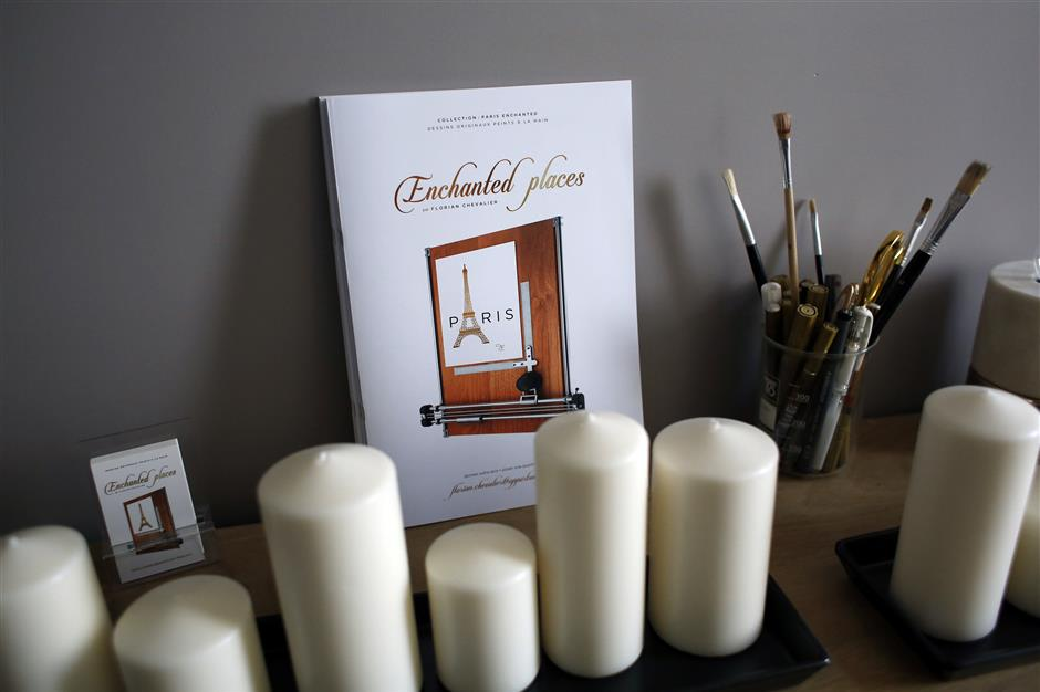 In this photo taken on Tuesday, Sept. 11, 2018, candles and information leaflet are displayed in an apartment located on Airbnb, in Paris. The spectacular growth of Airbnb in Paris, the top worldwide location for the internet giant is also raising alarms in the French capital. Some Parisians and officials at City Hall blame the site for driving Parisian families out of the city center, leading to school closures and concerns that the French capital is losing its life and charms. (AP Photo/Thibault Camus)