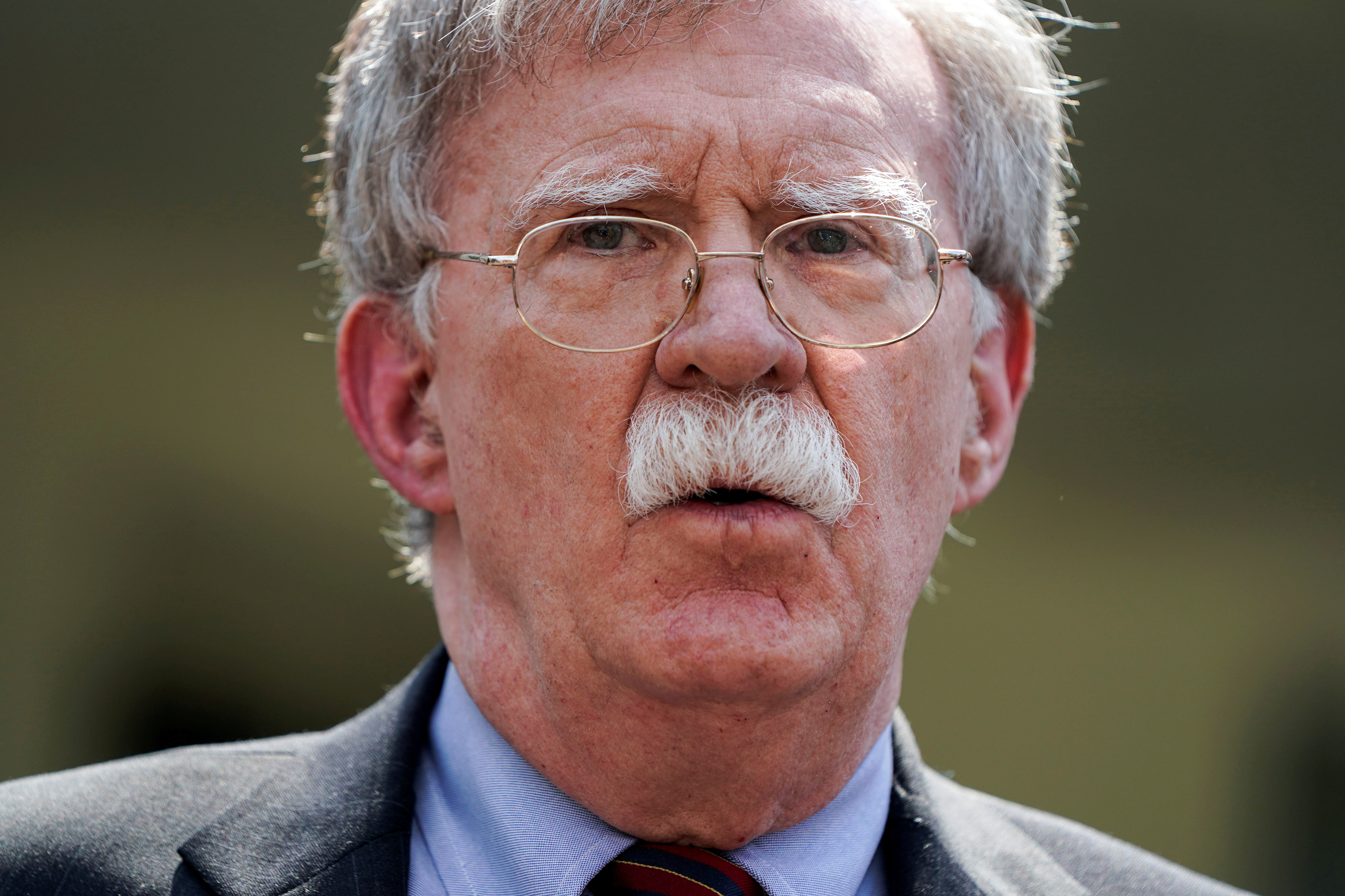 FILE PHOTO: White House national security adviser John Bolton speaks about the political unrest in Venezuela after violence broke out at anti-government protests near Caracas, outside the White House in Washington, U.S., April 30, 2019. REUTERS/Joshua Roberts