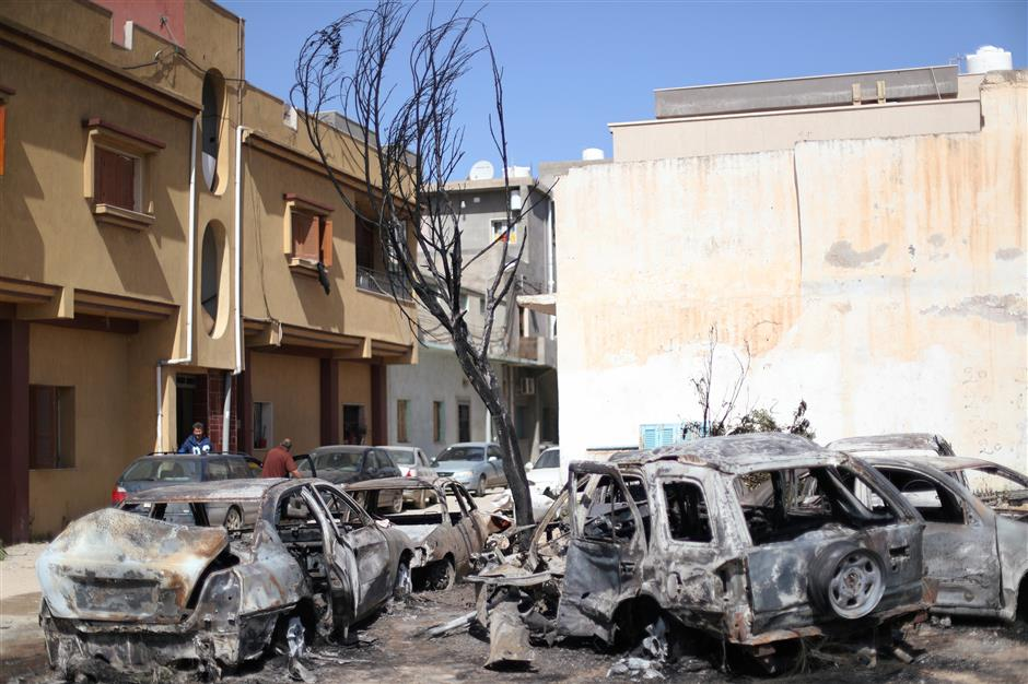 Damaged vehicles by an overnight shelling are seen in Abu Salim district in Tripoli, Libya April 17, 2019. REUTERS/Ahmed Jadallah