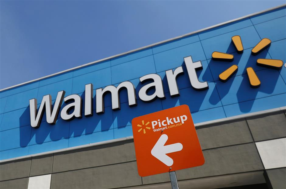 A Walmart sign is pictured at one of their stores in Mexico City, Mexico March 28, 2019. REUTERS/Edgard Garrido