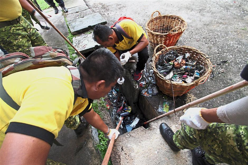 Some neighbourhoods organise gotong-royong to clean up their areas.