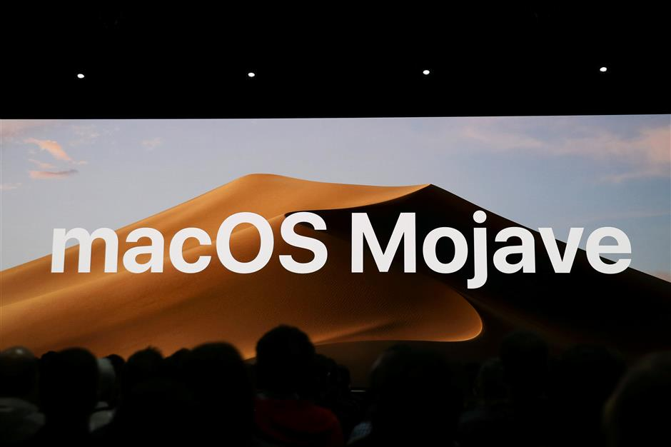 Apple introduces the upcoming MacOS Mojave at the Apple Worldwide Developer Conference (WWDC) in San Jose, California, U.S., June 4, 2018.   REUTERS/Elijah Nouvelage