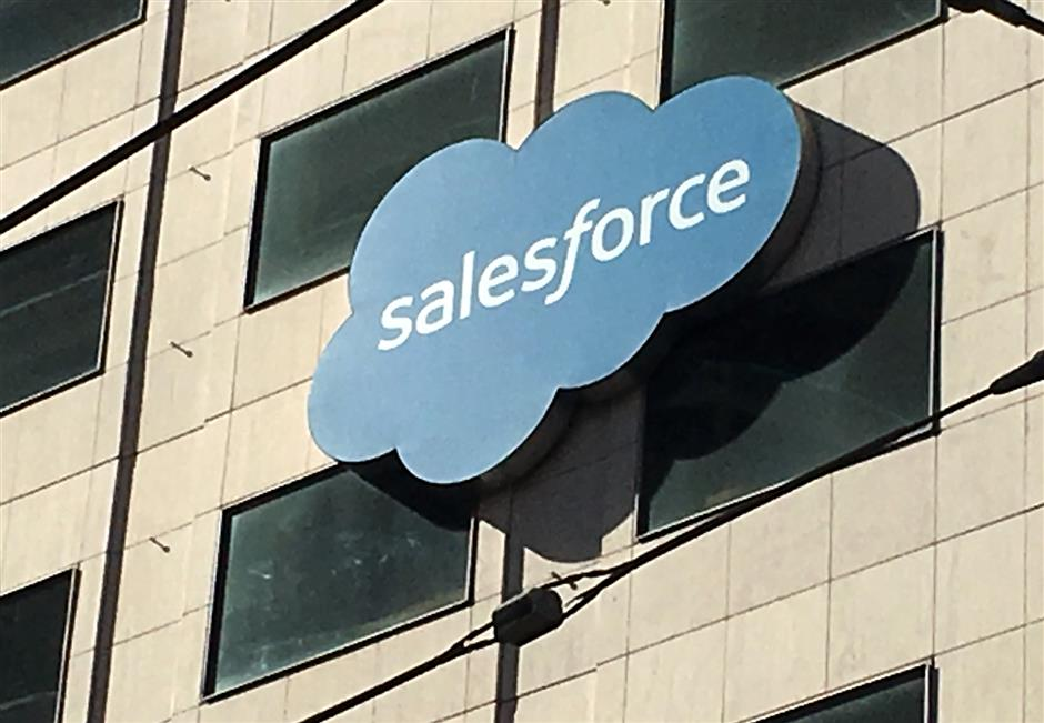 FILE PHOTO: The Salesforce logo is pictured on a building in San Francisco, California, U.S., October 12, 2016. REUTERS/Lily Jamali/File Photo