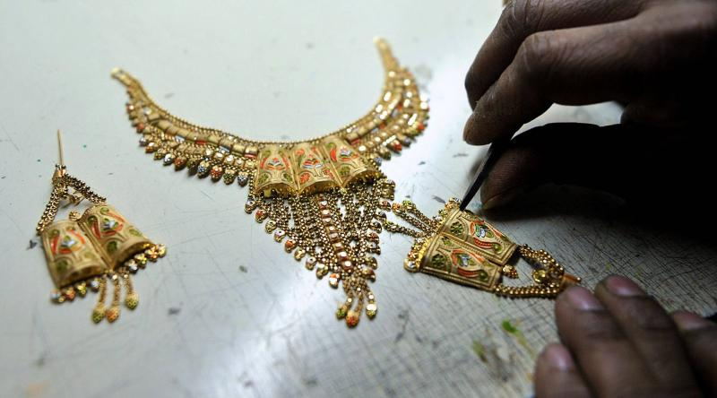 Spot gold had eased 0.2% to US$1,228.61 an ounce by 0032 GMT, after posting a weekly loss on Friday - AFP Photo.