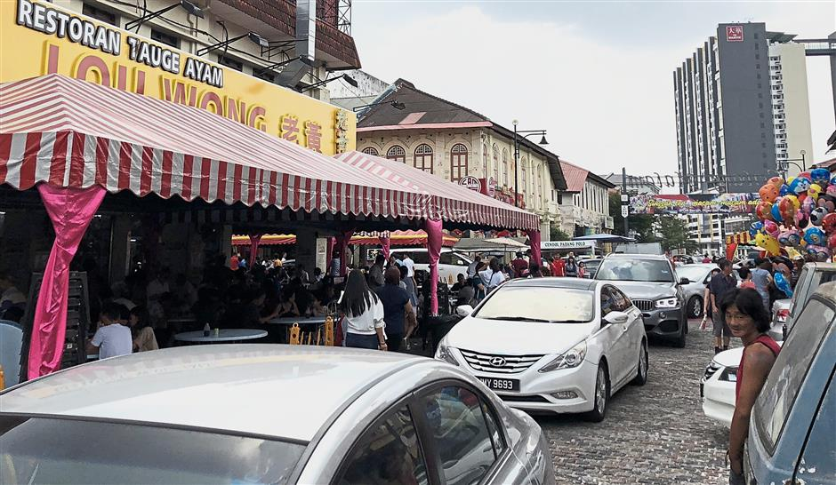 Cars entering Ipoh's New Town area, where many of Ipoh's famous restaurants and souvenir shops are located.