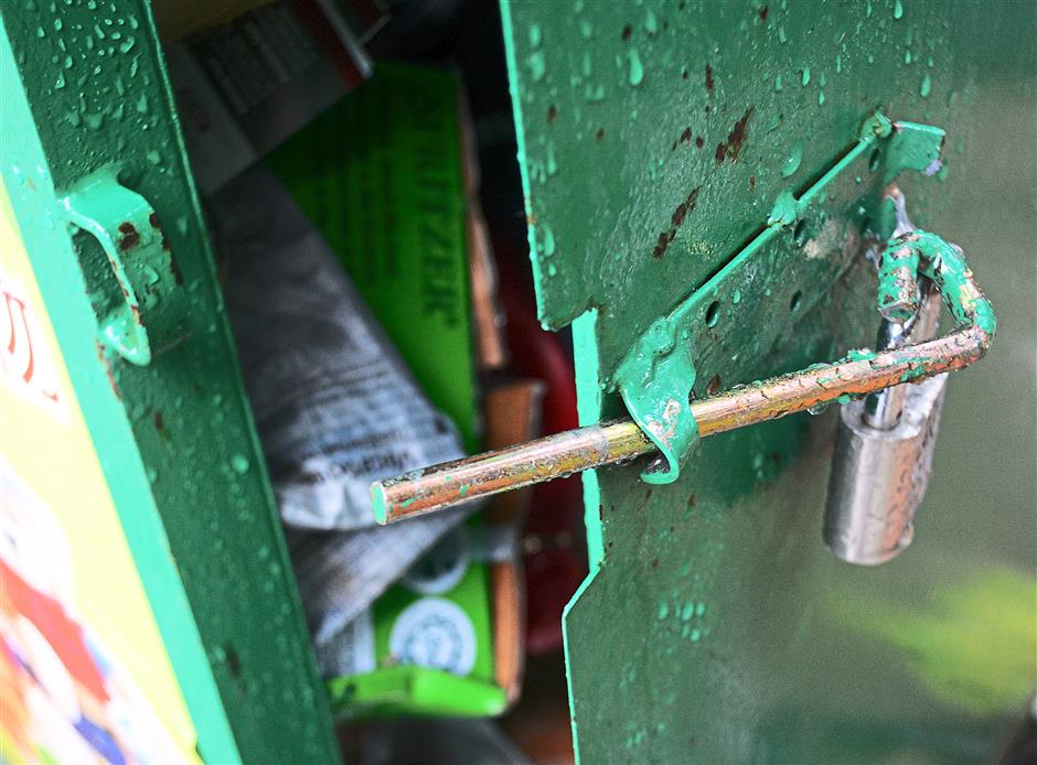 The lock was broken and items in the bins can be taken out.